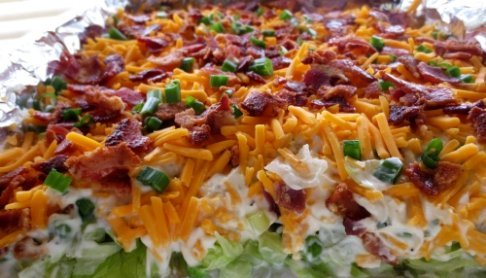 Seven Layer Salad Recipe - So creamy and crunch with lovely bacon and cheese topping #misshomemade | Thousands of recipes at MissHomemade.com