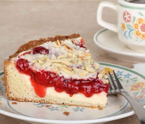 Pull out my cherry coffee cake recipe and begin the day with a cup of joe and this delicious breakfast cake.  Super moist with a cream cheese filling and a crumble nut topping #misshomemade