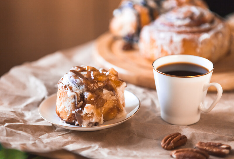 Impress with these Caramel Apple Cinnamon Buns. Downright decadent, everyone will ask for the recipe. Stuffed with buttery caramel apple filling, iced and drizzled with caramel sauce. #misshomemade
