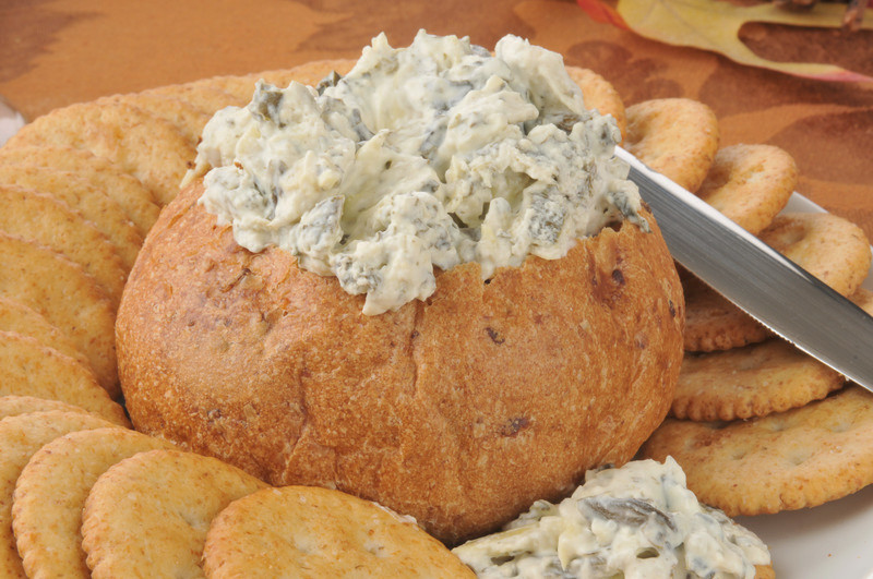 Spinach Artichoke Dip in hollowed out bread.  Warm, rich and gooey; so good! #misshomemade