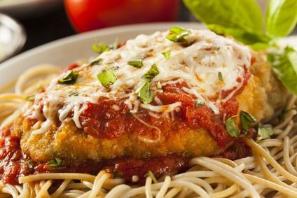 Delicious Chicken Parmesan Recipe - Juicy fried chicken breast smothered in a fresh sweet tomato sauce and topped with cheese.  #misshomemade | Thousands of homemade recipes at MissHomemade.com