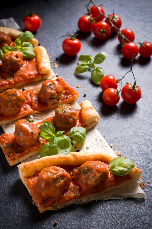 Meatball pizza recipe? Yes, and you are going to love it! Tomato sauce, juicy meatballs and fresh basil.  You may also top it with shredded mozzarella before taking it out of the oven. #misshomemade