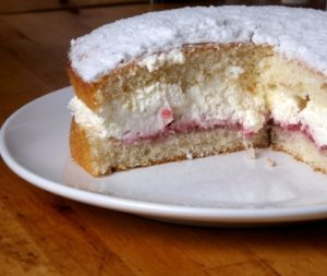 Victoria Sponge Cake - This is a basic sponge cake and sandwiched with a fluffy creamy filling and jam.  To die for!  #misshomemade