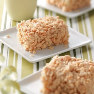 Peanut Squares Recipe - small white cake squares, frosted and rolled in finely chopped nuts. A bakery staple in the Midwest. Heaven. #misshomemade